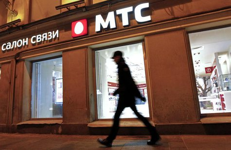 A man walks past an MTS shop in St.Petersburg March 18, 2013. REUTERS/Alexander Demianchuk
