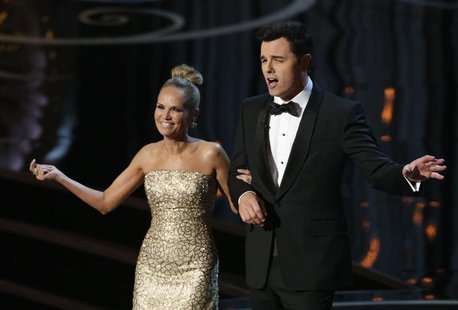 Kristin Chenoweth and Oscars host Seth MacFarlane perform the closing number at the 85th Academy Awards in Hollywood, California, February 2