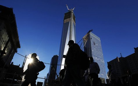 People walk by the World Trade Center site before ceremonies marking the 11th anniversary of the September 11, 2001 attacks on the World Tra