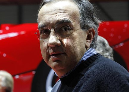 Fiat CEO Sergio Marchionne poses after the presentation of the new LaFerrari hybrid car on the Ferrari stand during the first media day of t