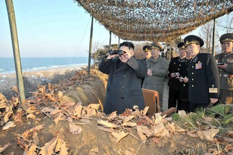 North Korean leader Kim Jong-Un (L) watches soldiers of the Korean People's Army (KPA) taking part in the landing and anti-landing drills of