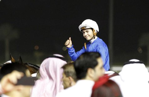 Mickael Barzalona, riding Monterosso, celebrates after winning the ninth and final race of the 17th Dubai World Cup at the Meydan racecourse
