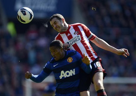 Sunderland's John O'Shea (R) challenges Manchester United's Antonio Valencia during their English Premier League soccer match in Sunderland,