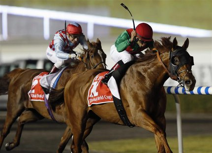 Joel Rosario (R), riding Animal Kingdom of the U.S., races against Gerald Mosse, riding Red Cadeaux of Britain, during the ninth and final r