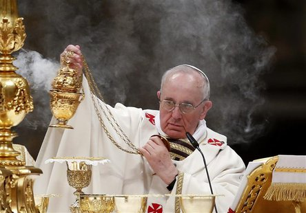 Pope Francis holds the incense burner as he leads a vigil mass during Easter celebrations at St. Peter's Basilica in the Vatican March 30, 2