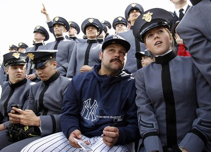 New York Yankees relief pitcher Joba Chamberlain looks on from the bleachers with cadets from the U.S. Military Academy during an exhibition