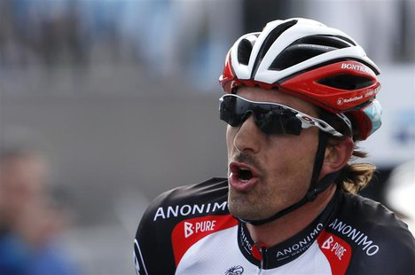 RadioShack team rider Fabian Cancellara of Switzerland celebrates winning the 97th Ronde van Vlaanderen (Tour of Flanders) Classic cycling r