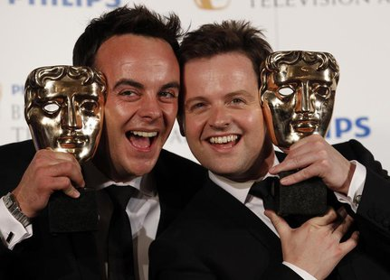 Presenters Ant McPartlin (L) and Dec Donnelly pose with the British Academy Television Awards Entertainment Performance Award at the Palladi