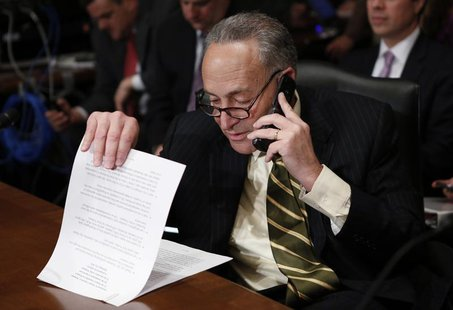 U.S. Senator Charles Schumer looks through his prepared remarks before introducing Jack Lew, U.S. President Barack Obama's nominee to lead t