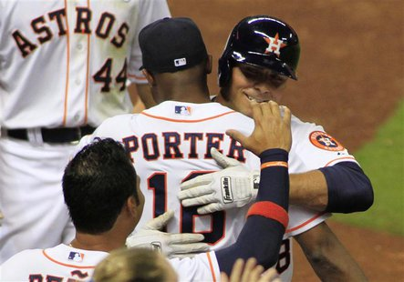 Houston Astro's Rick Ankiel (R) hugs manager Bo Porter after his three-run home run in the sixth inning against the Texas Rangers during the