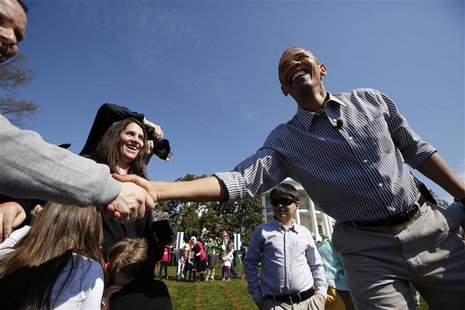 U.S. President Barack Obama greets the parents of children participating in the 135th annual Easter Egg Roll on the South Lawn of the White