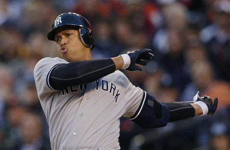 New York Yankees Alex Rodriguez swings through a pitch during the sixth inning of Game 4 of their MLB ALCS baseball playoff series against t