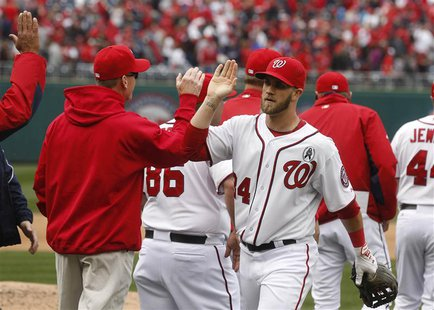 Washington Nationals Bryce Harper celebrates after the last out of a opening day MLB National League game against Miami Marlins in Washingto
