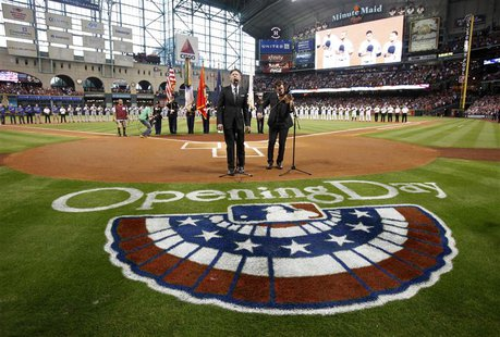 Singer Lyle Lovett and fiddler Luke Bulla play the national anthem before the Houston Astros play the Texas Rangers on opening night of the