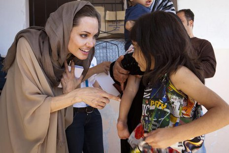 UNHCR Special Envoy Angelina Jolie meets Syrian refugees in the Bekaa Valley, Lebanon in September in this UNHCR handout photo. REUTERS/UNHC