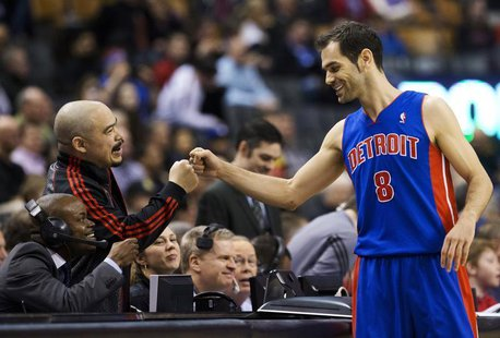 Detroit Pistons' Jose Calderon greets announcer Herbie Kuhn (L) before his team plays the Toronto Raptors in their NBA basketball game in To