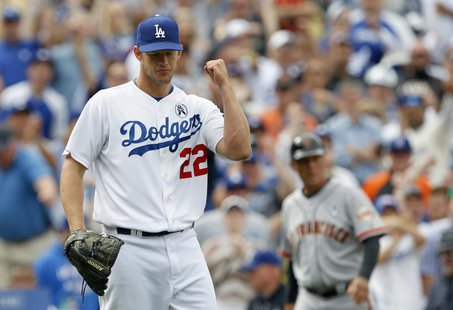 Los Angeles Dodgers starting pitcher Clayton Kershaw pumps his fist as the Dodgers defeat the San Francisco Giants 4-0 during their MLB Nati