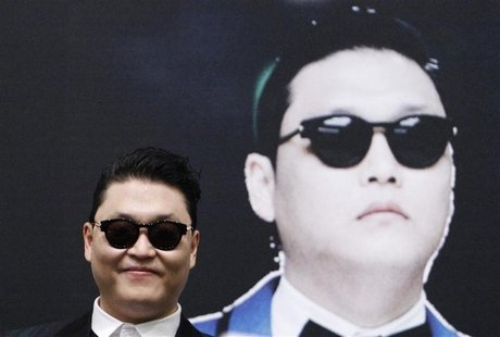 South Korean rapper Psy attends a news conference before a free concert at the Marina Bay Sands in Singapore, in this December 1, 2012 file