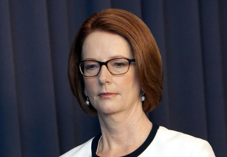 Australian Prime Minister Julia Gillard leaves a media conference at Parliament House in Canberra March 21, 2013. REUTERS/Andrew Taylor