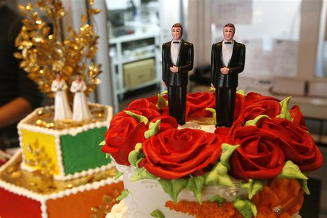 Bride and groom figurines are on display on wedding cakes at Cake and Art bakery in West Hollywood, California June 4, 2008. REUTERS/Mario A