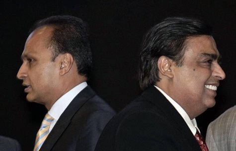 Mukesh Ambani (R), chairman of Reliance Industries, and his brother Anil Ambani, chairman of Reliance Group, attend the inauguration ceremon