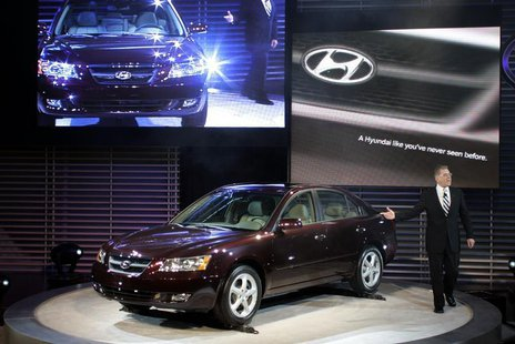 President and CEO of Hyundai America talks about the 2006 Hyundai Sonata at the 2005 North American International Auto Show. REUTERS/Gregory