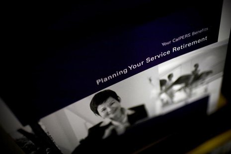 Retirement plan brochures are seen in a rack at the Calpers regional office in Sacramento, California October 21, 2009. REUTERS/Max Whittake