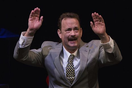 Actor Tom Hanks gestures to the audience after his performance in the premiere of the play Lucky Guy in New York, April 1, 2013. REUTERS/Luc