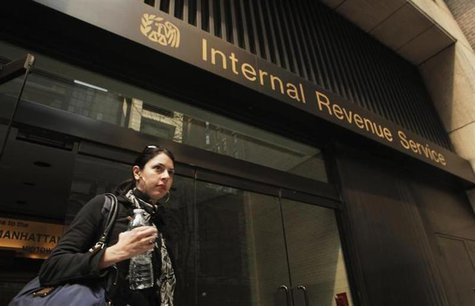 woman walks out of an Internal Revenue Service office in New York