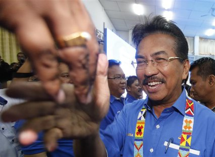 Malaysia's state of Sabah Chief Minister Musa Aman is greeted upon his arrival at his National Front coalition's pre-election campaign in Ke