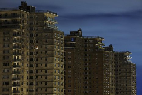 A single room is illuminated in a block of high-rise apartment buildings in the Brighton Beach neighborhood of New York, November 2, 2012. R