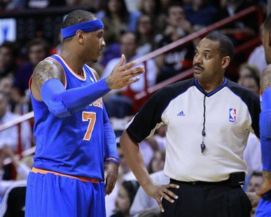 New York Knicks small forward Carmelo Anthony (L) argues with referee Bennie Adams after Adams called a technical foul on Anthony as they me