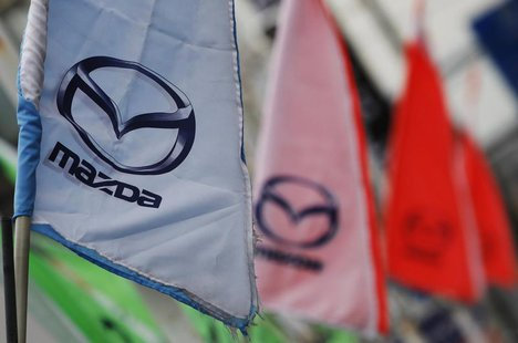 Logos of Mazda Motor Corp are seen at a dealership in Tokyo March 1, 2012. REUTERS/Toru Hanai