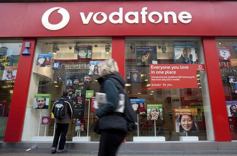 A pedestrian passes a Vodafone store on Oxford Street in central London, November 10, 2009. Vodafone, the world's largest mobile phone opera
