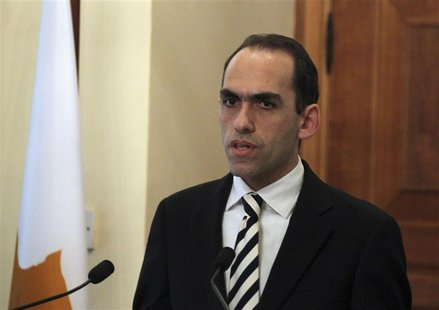 Newly-appointed Cyprus Finance Minister Harris Georgiades speaks during a ceremony at the Presidential Palace in Nicosia, Cyprus April 3, 20