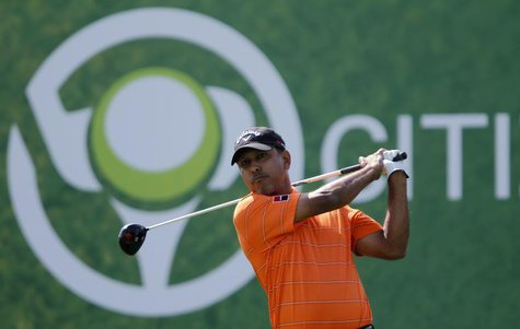 Jeev Milkha Singh of India watches his shot from the second tee during the fourth and final round of the Dubai Desert Classic at the Emirate