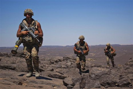 French soldiers patrol in the Terz valley, about 60 km (37 miles) south of the town of Tessalit in northern Mali March 20, 2013. REUTERS/Fra