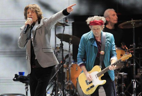 "Mick Jagger (L) and Keith Richards perform onstage during the Rolling Stones final concert of their ""50 and Counting Tour"" in Newark, New Je"