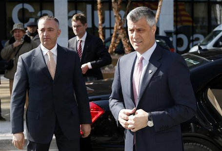 Kosovo's Prime Minister Hashim Thaci (R) arrives for a meeting with Serbian Prime Minister Ivica Dacic (unseen) and European Union foreign p