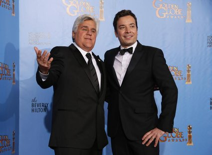 Late night talk show hosts Jay Leno (L) and Jimmy Fallon pose backstage at the 70th annual Golden Globe Awards in Beverly Hills, California,