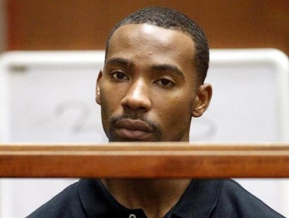Former Los Angeles Lakers guard Javaris Crittenton (R) appears in Los Angeles Superior Court for an extradition hearing with attorney Brian