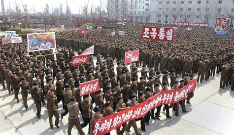 North Koreans attend a rally held to gather their willingness for a victory in a possible war against the United States and South Korea in N