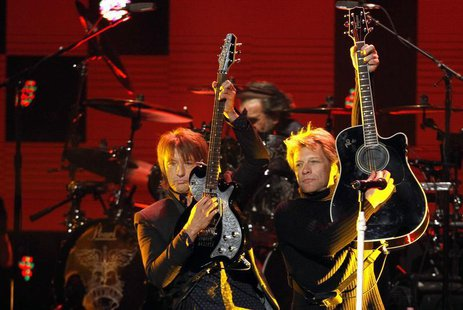 "Richie Sambora (L) and Jon Bon Jovi perform during the ""12-12-12"" benefit concert for victims of Superstorm Sandy at Madison Square Garden i"