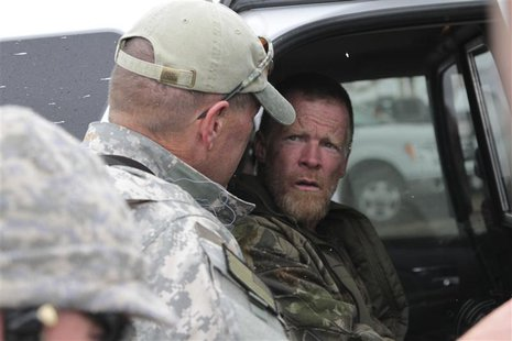 "Troy James Knapp, known as the ""Mountain Man,"" is taken into custody by Sanpete County sheriffs in this April 2, 2013 handout photo, after b"