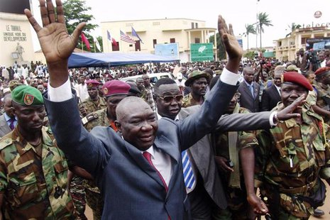 Central African Republic's new leader Michel Djotodia greets his supporters at a rally in favor of the Seleka rebel alliance in downtown Ban