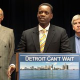 Lawyer Kevyn Orr (C) addresses the media, as Detroit Mayor Dave Bing (L) and Michigan Governor Rick Snyder listen, after Snyder announced Or