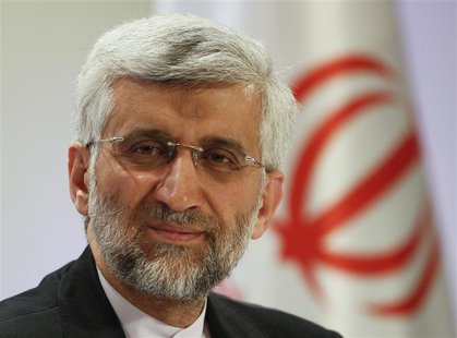 Iran's Supreme National Security Council Secretary and chief nuclear negotiator Saeed Jalili listens during a news conference in Almaty Febr