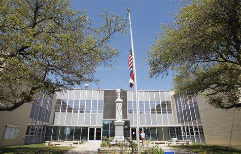 The flags fly half staff at Kaufman County Courthouse where slain District Attorney Mike McLelland worked in Kaufman, Texas April 1, 2013. R