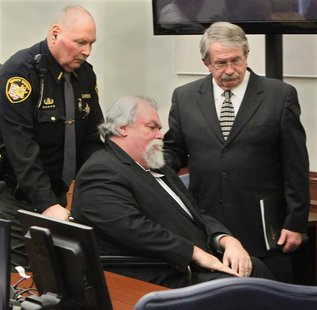 Defense attorney Lawrence J. Whitney (R) accompanies convicted Craigslist murderer Richard Beasley after the jury recommended the death pena