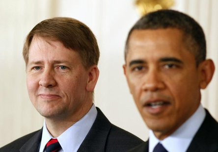 U.S. President Barack Obama (R) speaks next to Richard Cordray after Obama announced Cordray's renomination to lead the Consumer Financial P